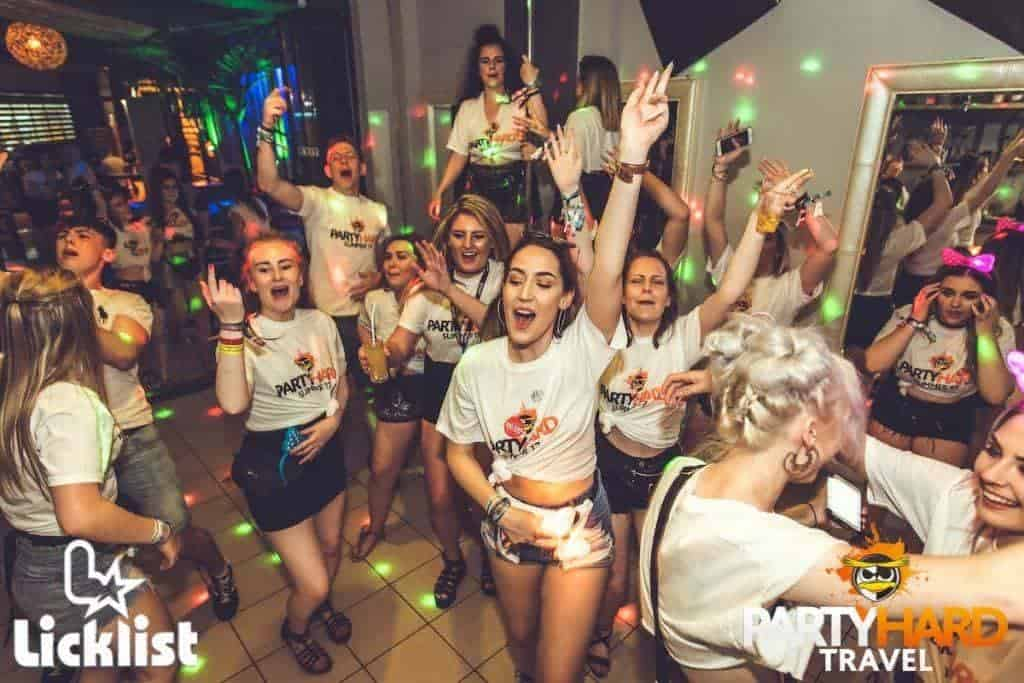revellers enjoying bar crawl event in malia