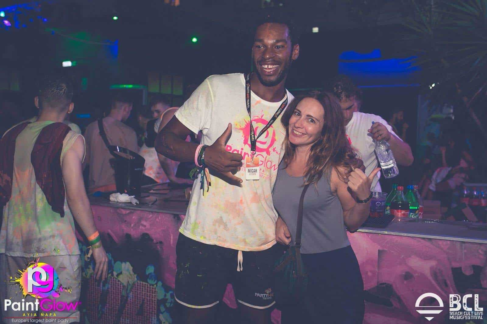 Posing with the DJ at Paint Glow Party