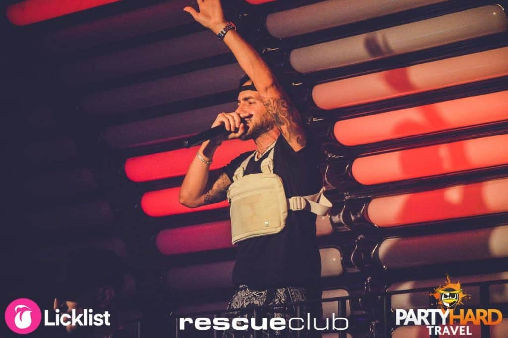 House DJ with Microphone on Stage at Rescue Club, Laganas