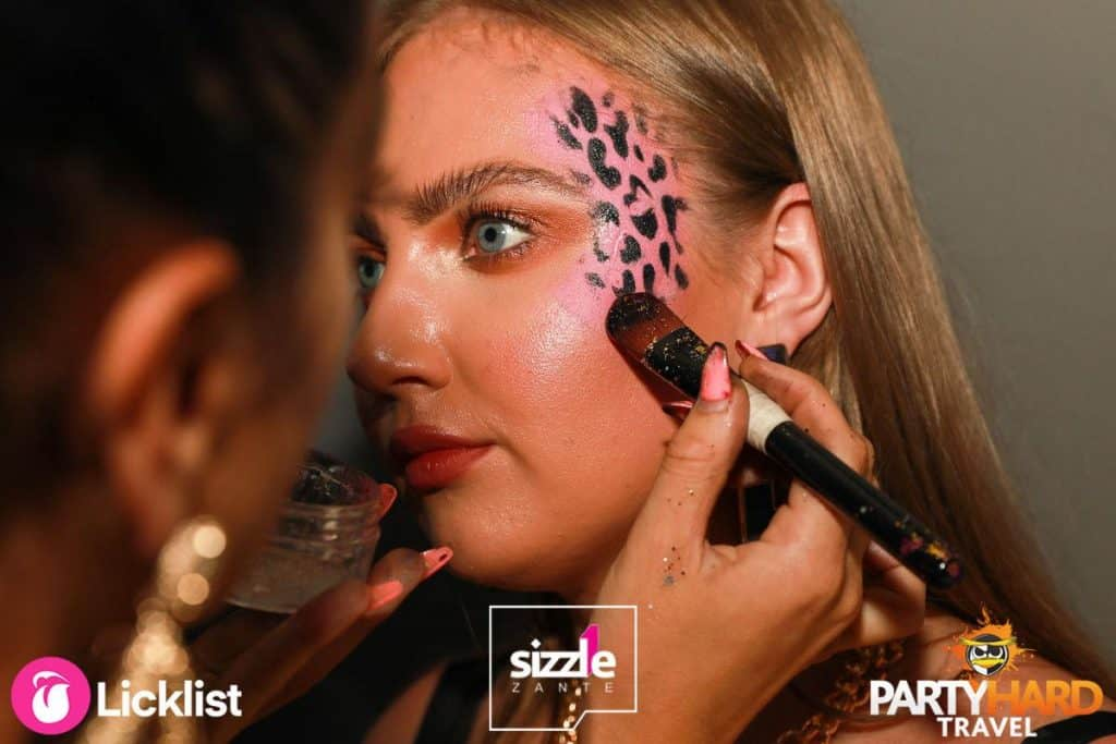 Girl having face painted in Black on Pink Camouflage Design
