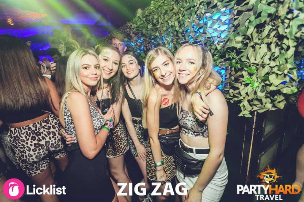 Group of Girls posing for a late night photo inside the modern themed Zag Zag Club