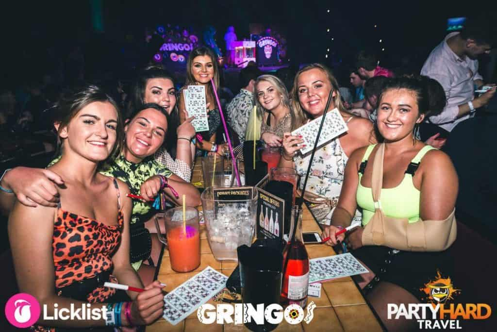 Girls with their Bingo Cards ready to play at Gringos Club, in Malaga, Mallorca