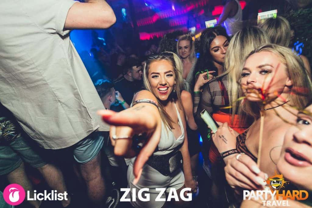 Girl pointing and having a laugh in the crowd at Famous Malia Night Club