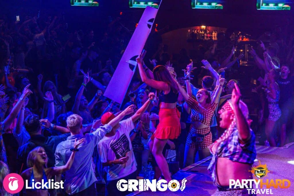 Girl on stage breaking the scenery at Gringos Club as the crowd cheer her on in Mallorca