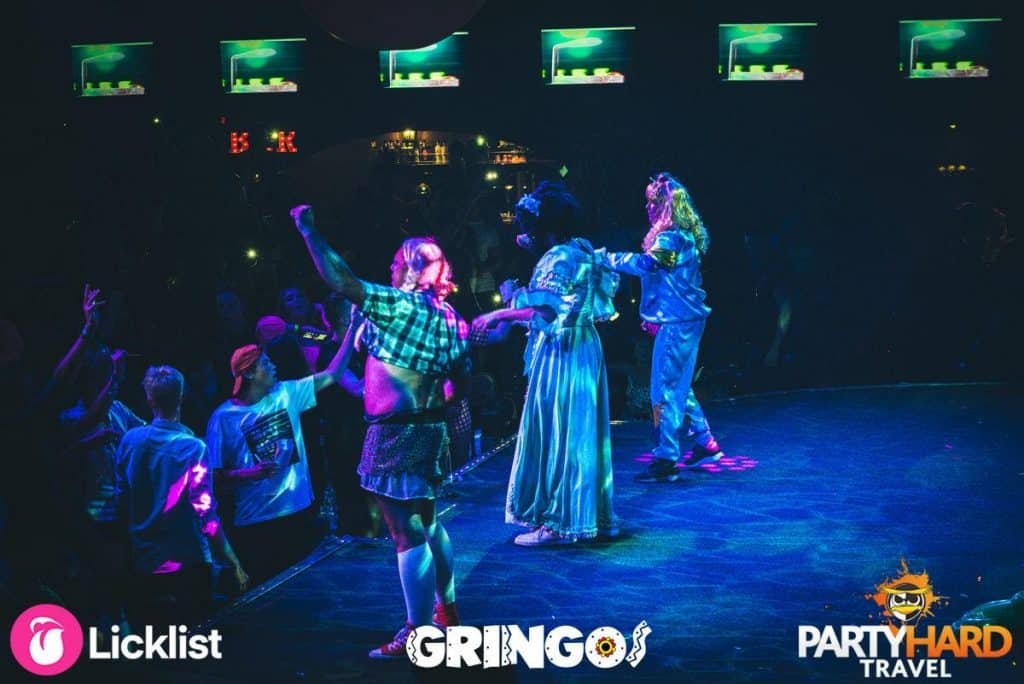 Actors in costume performing on stage performing to the audience at Gringos, Magaluf