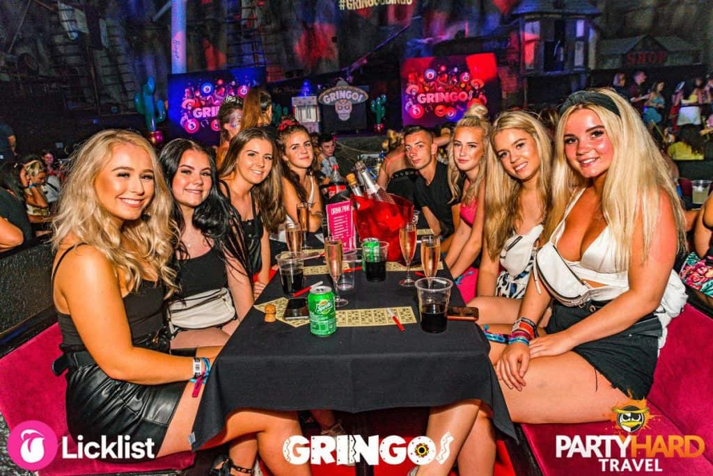 Group of Girls sat round table with the Sprite, Cola and Champagne, ready for Bingo at Gringos Club