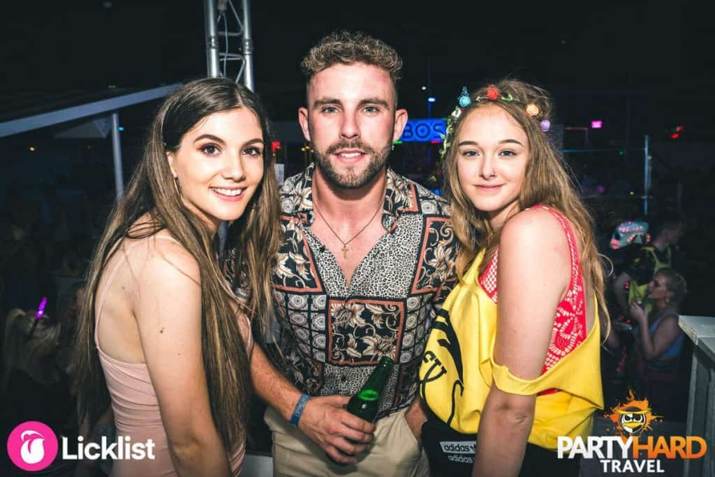 Lad with two girls in a Magaluf Nightclub