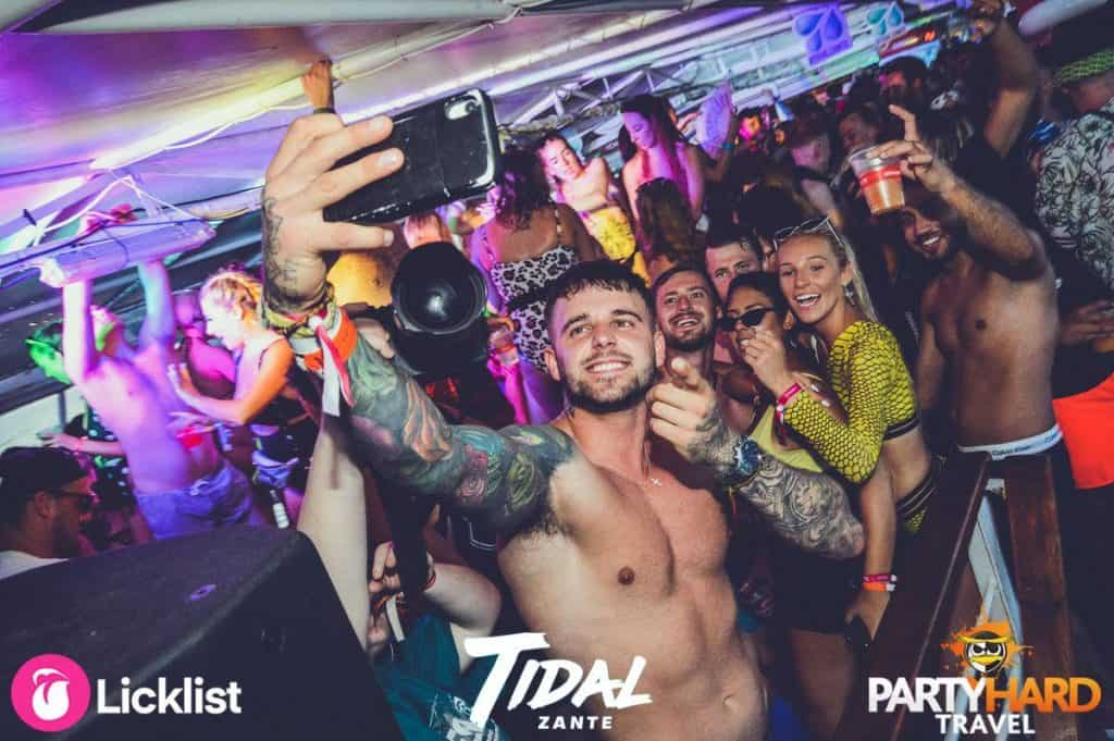 Lad taking a selfie group photo on the dance floor of the Zante Tidal Boat Party