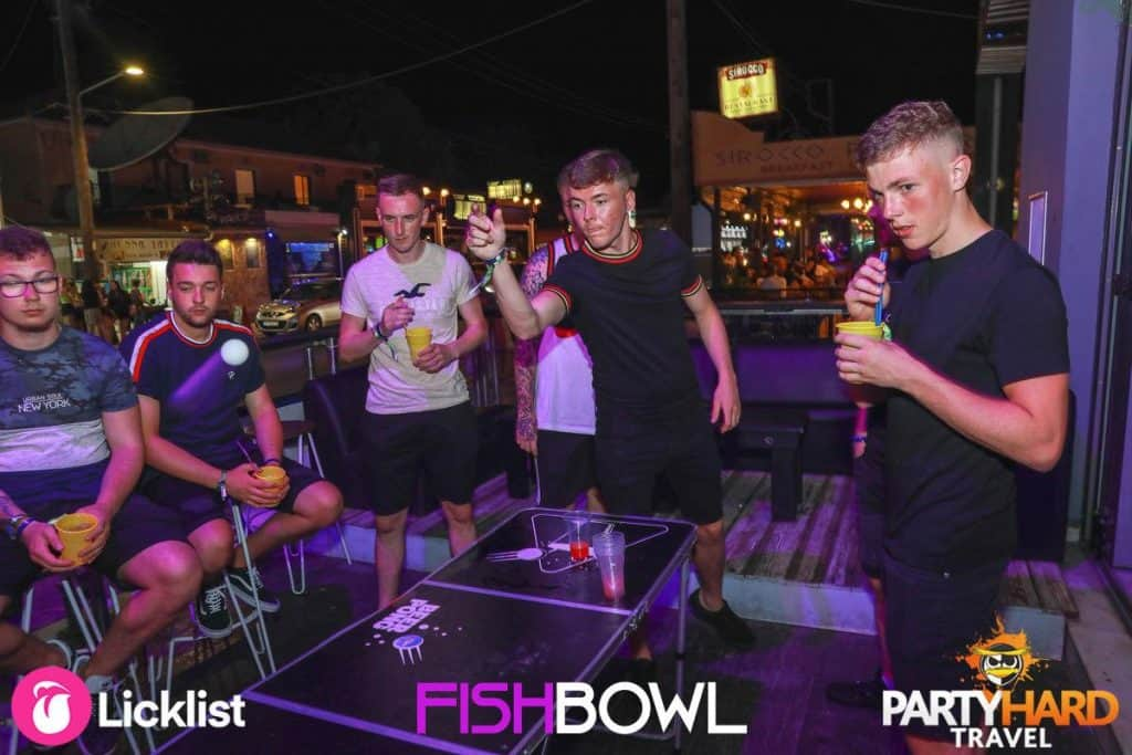 The Lads Working Out How to Play the Beer Pong Game