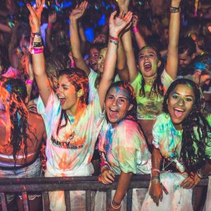 girls covered in paint at paint party
