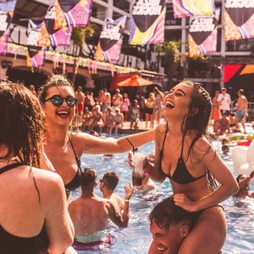 pool girl laughing on shoulders