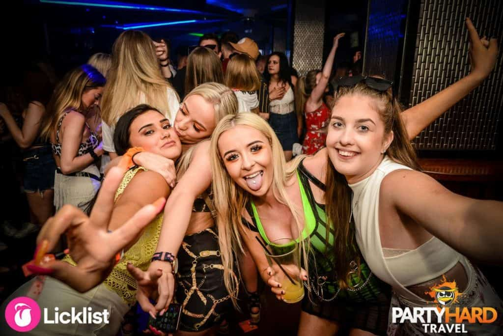 Group of girls partying, drinking and having fun in a Magaluf Nightclub