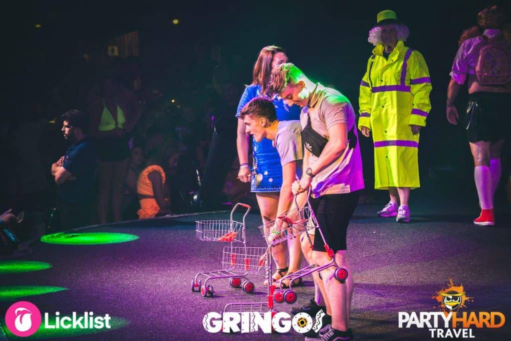 Contestants on stage with trolleys ready to play supermarket challenge in Gringos club