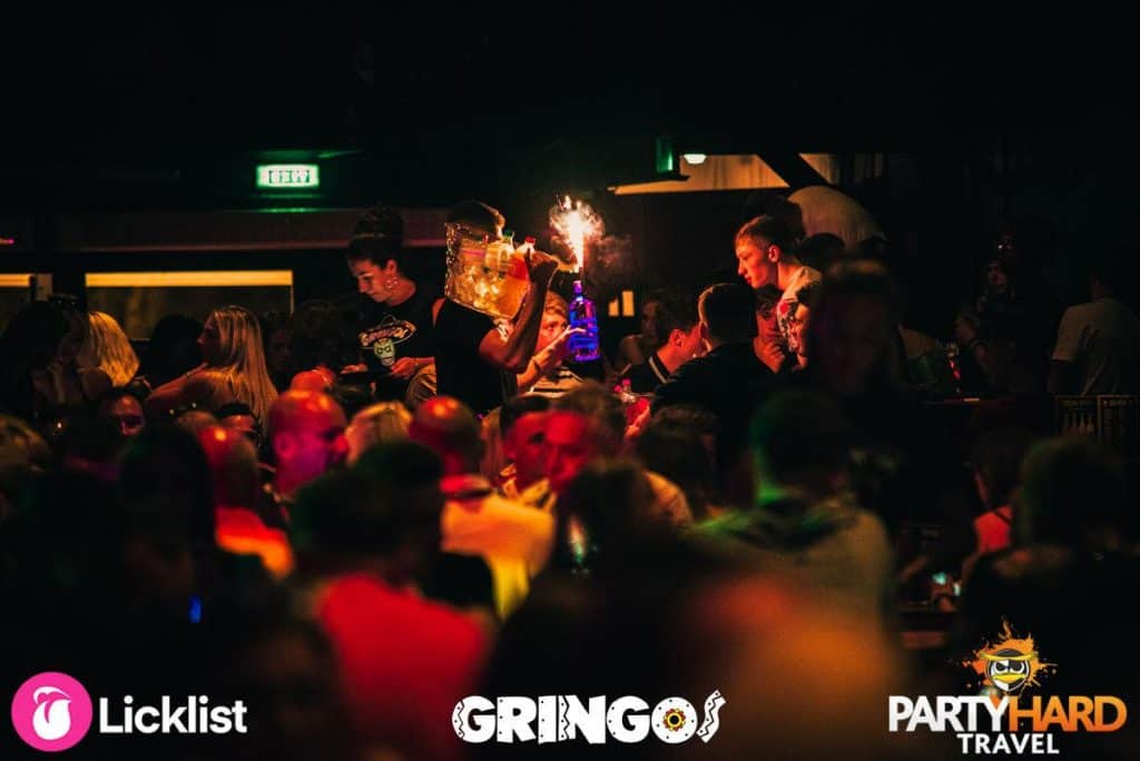Lads ordering drinks and cocktails with sparklers on night out at Gringos party club