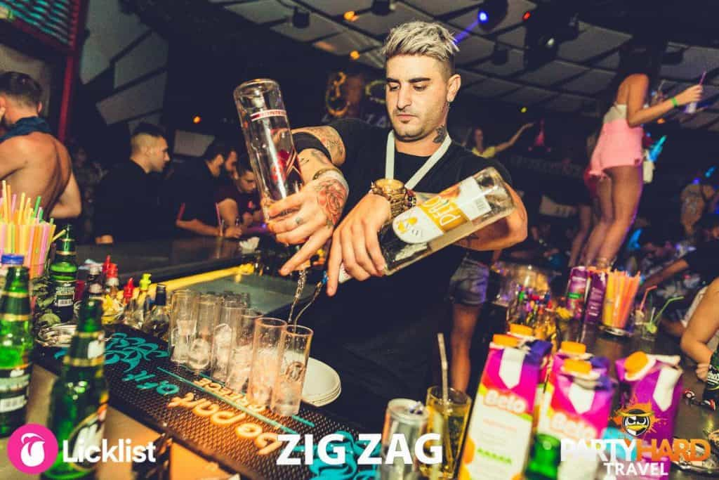 Resident Zig Zag Club Bartender pouring the drinks