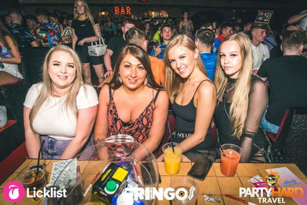 Group of four girlfriends waiting for the Bingo to start at Gringos Party Rave Club