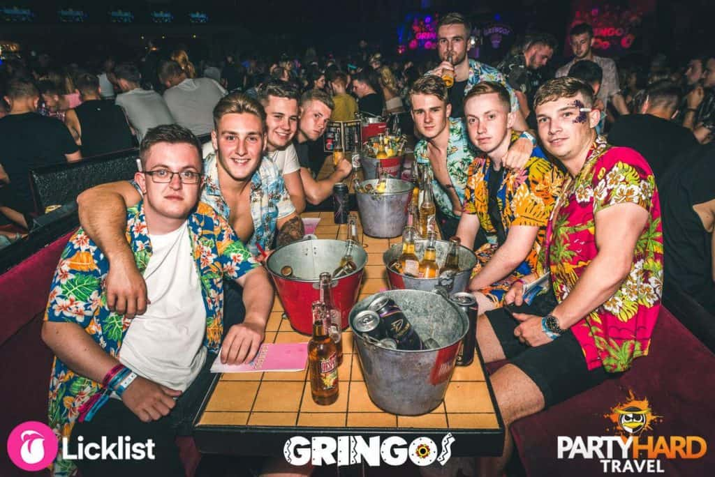 Group of Lads Dressed to Impress in their Hawaiian shirts and table full of beer in Magaluf