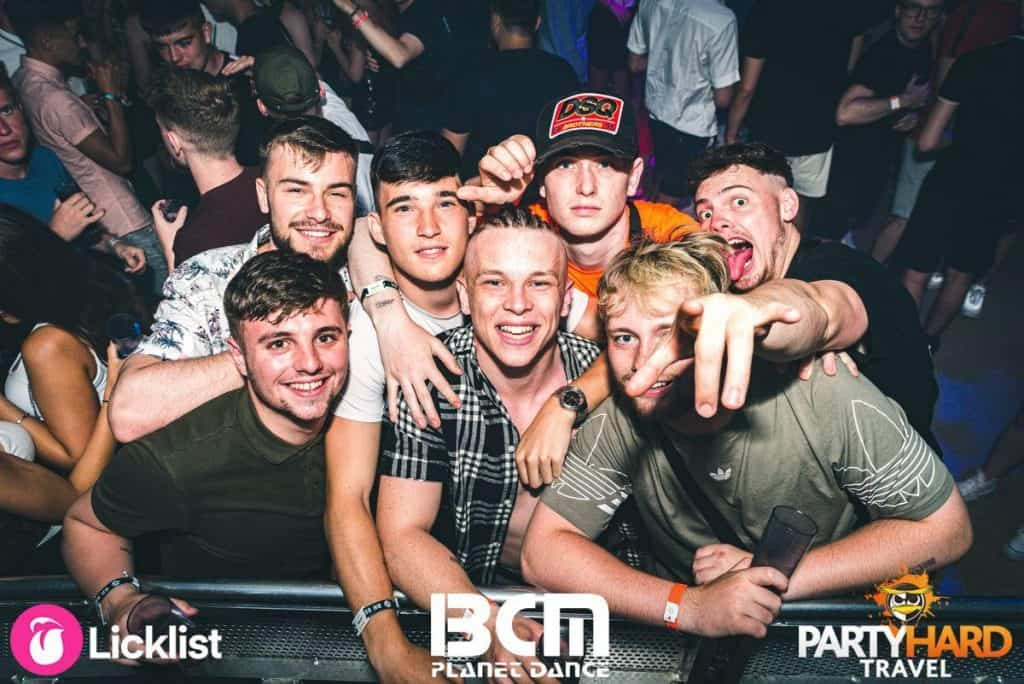 Group of Lads gathering at the edge of Stage, attracting the DJ's attention