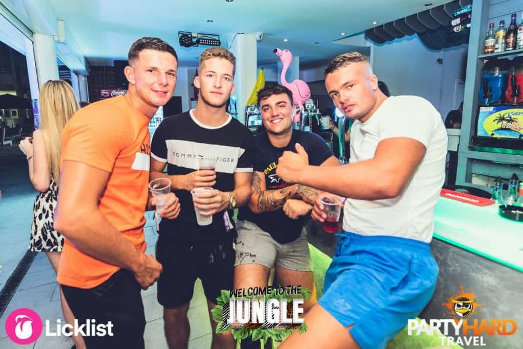 Four Lads Drinking at the Kavos Pool Bar