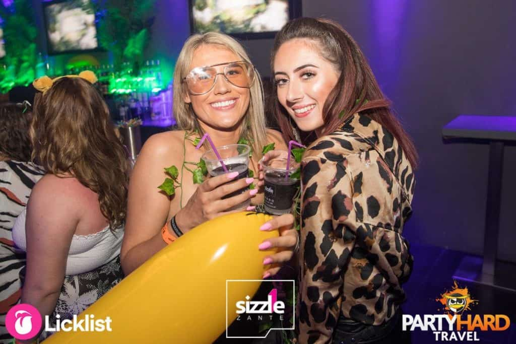 Girls with Drinks in Party Mode With Yellow Inflatable