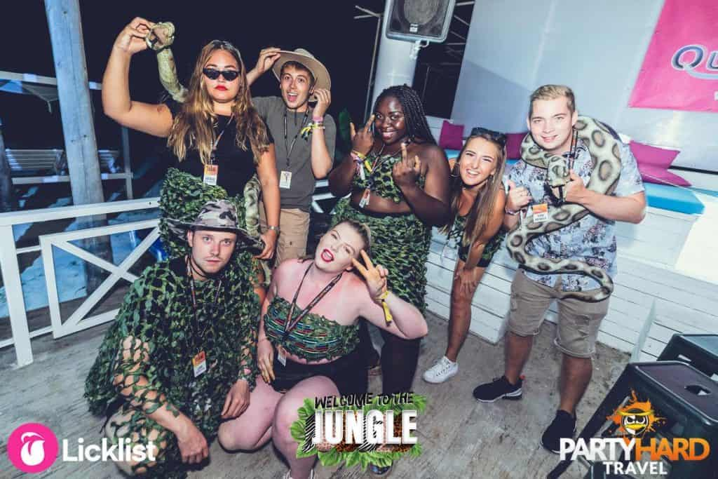 Lads and Girls Wearing Jungle Attire and Carrying Fake Snakes in Kavos