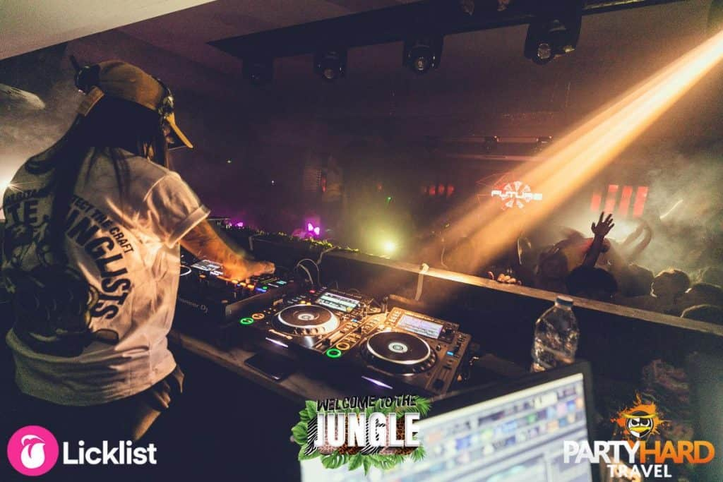 DJ Operating the Mixing Decks on Rave Jungle Event at Future Nightclub