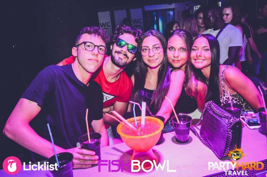 Group of Lads and Girls, Ready to attempt a large bowl of Punch