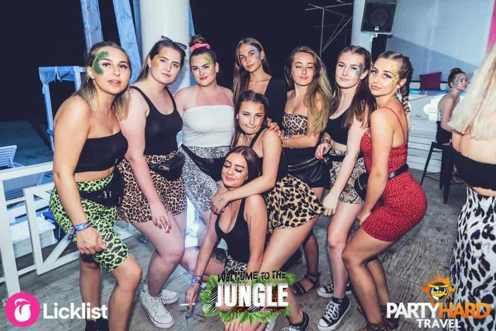 Group of Girls in Leopard skin Jungle Themed Outfits at Night Outside NightClub in Kavos