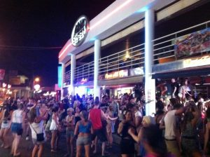 crowd outside 42nd street on kavos strip