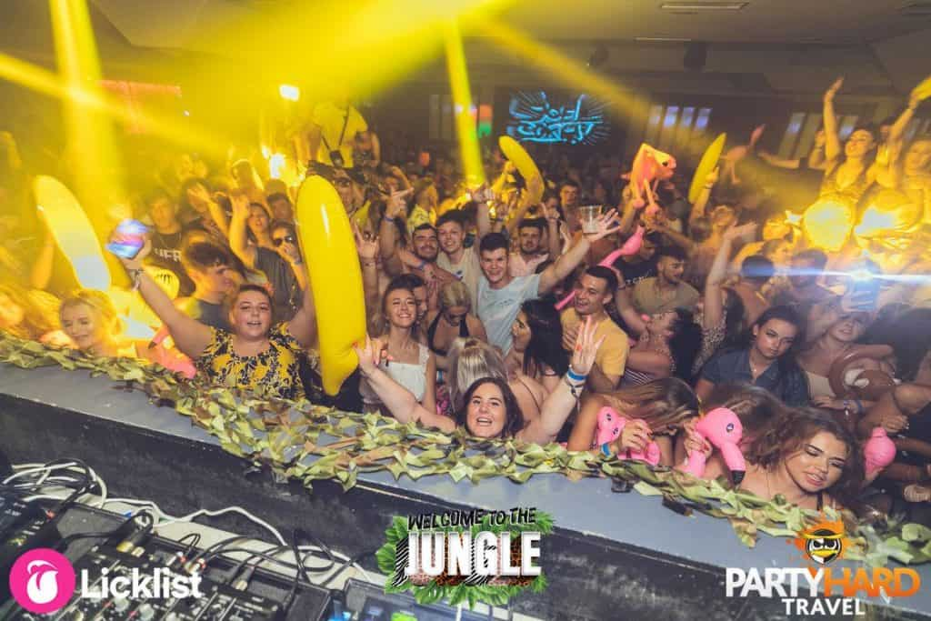Jungle Theme at Future Nightclub, Partygoers with inflatable Bananas and Pink Flamingos