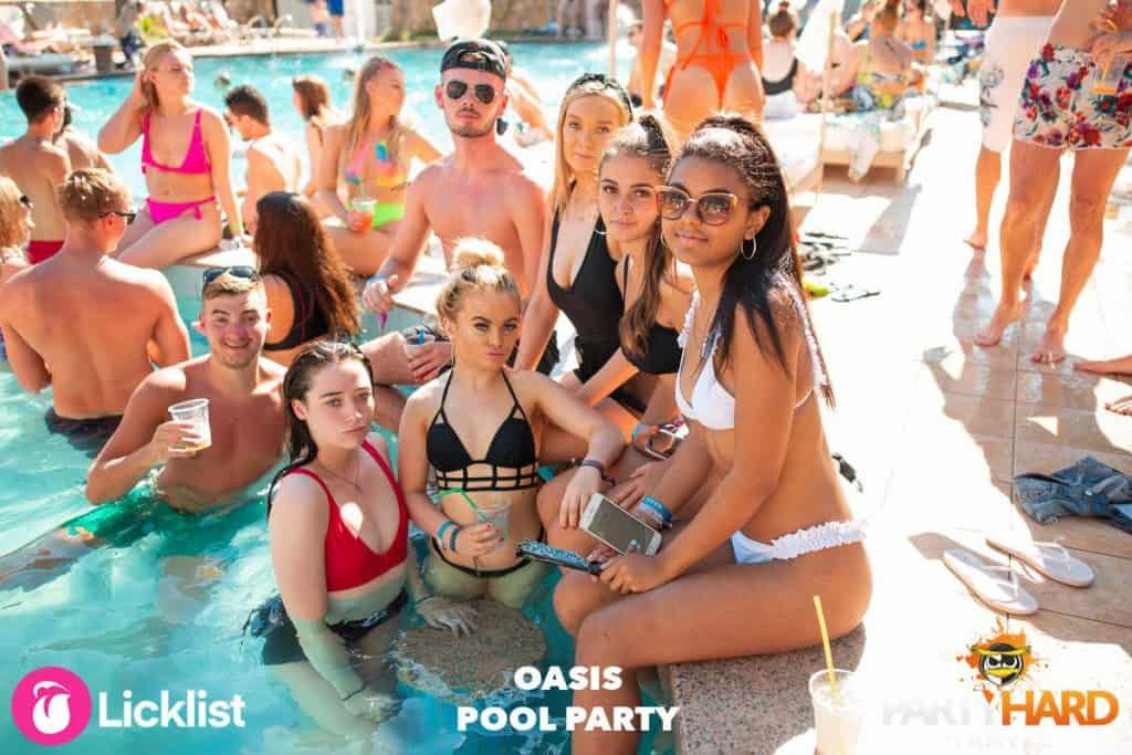 Group of Girls and Lads sat in the Village Oasis Studios Swimming Pool