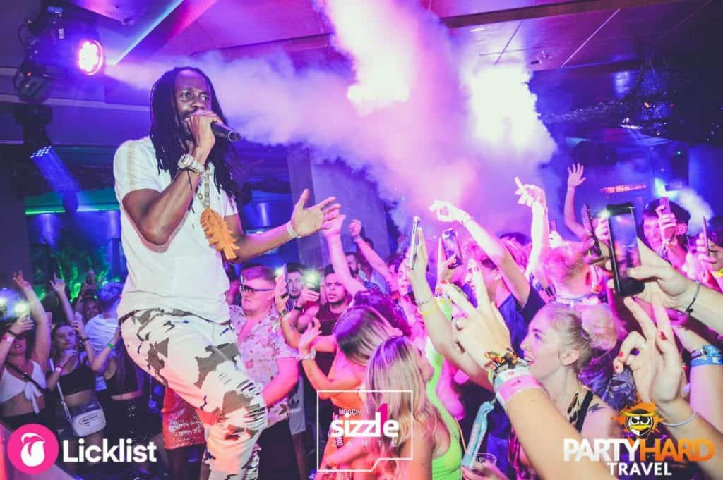 Performer With Microphone Singing and Rapping With Clubbers at Sizzle Club