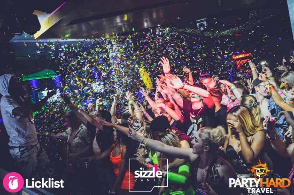 Late Night at Sizzle Club, Confetti Paper Falling As Performer Sings to Clubbers