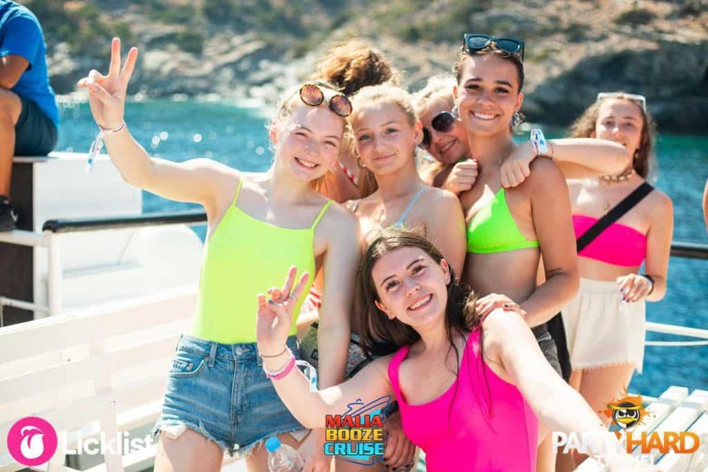 Group of Girls Posing For their Holiday Photo on the Malia Cruise
