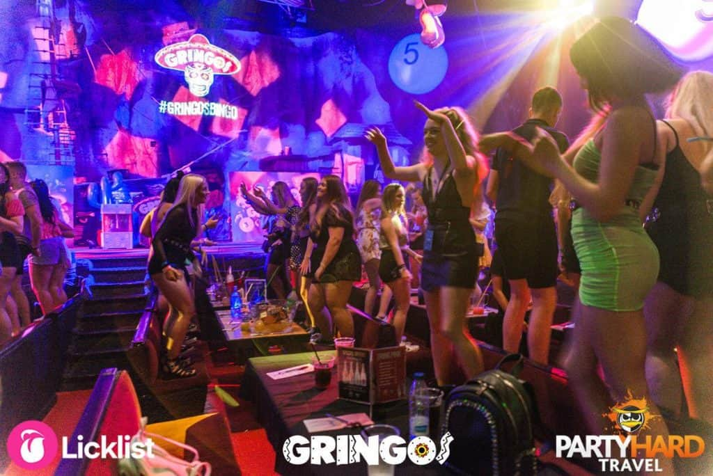 Girls standing on their seats at an experience like no other at Gringos Bingo Venue