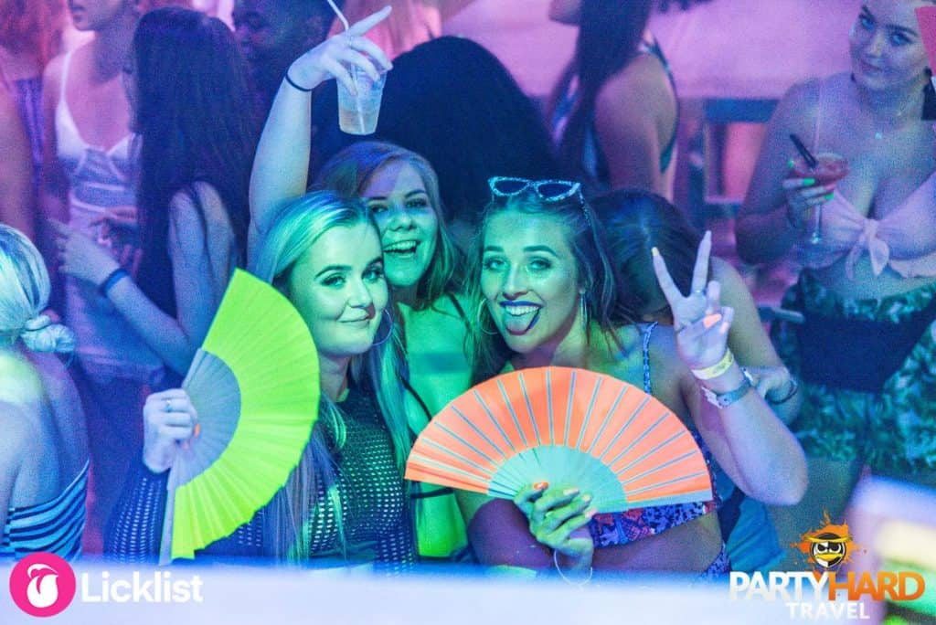 Party Girls at Magaluf Nightclub Waving Coloured Fans
