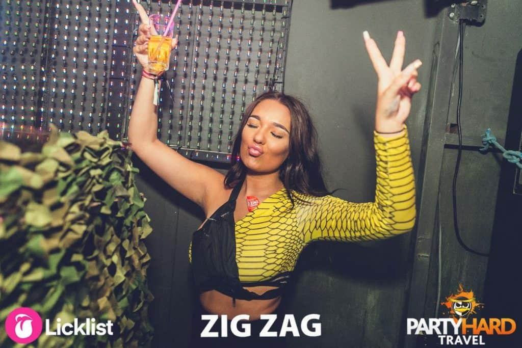 Female Performer wearing snakeskin top Meditating before going on stage at Zig Zag Club
