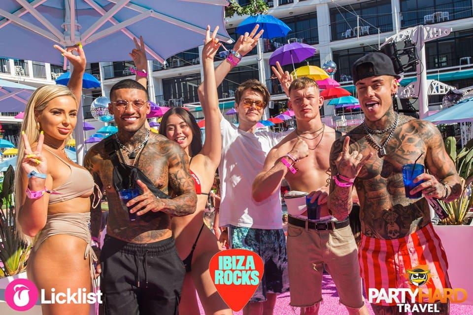 Celebrity reality TV stars Georgia Cole, Chet Johnson, Callum Izzard, Harrison Web and Millie Hannah waving at Ibiza Rocks Hotel Pool