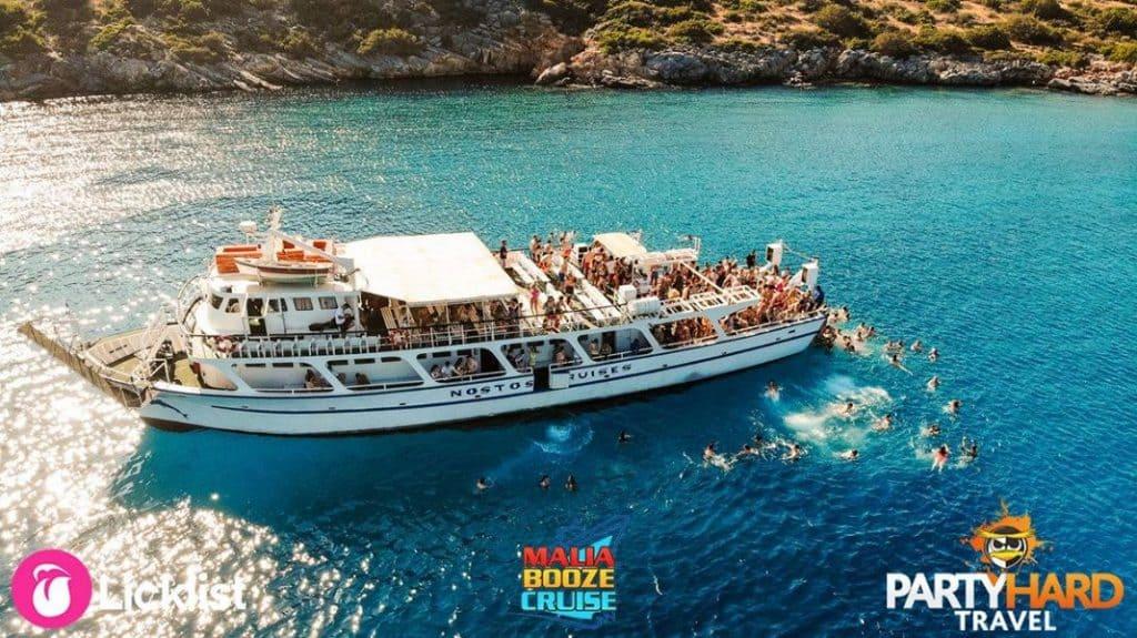 Overhead photo from drone of the Nostos Cruises Pleasure Boat and Passengers taking a dip
