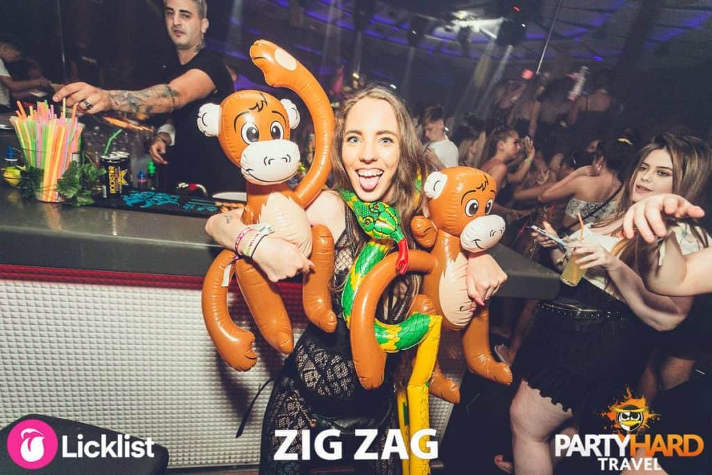 Girl posing at Zig Zag Club Bar with Inflatable Monkeys and Snake