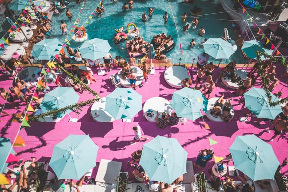 View of the Ibiza Rocks main pool packed with sunbathers taken from the hotel apartments balcony