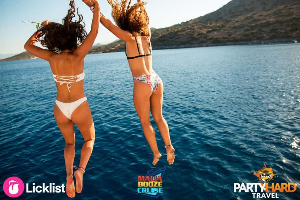 Two Girls Jumping off the Boat into the Mediterranean Sea off the Coast of Crete