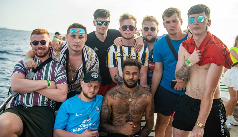 The lads strike a cool pose for the holiday Photograph on deck of the Pukka Up Ibiza Party Boat