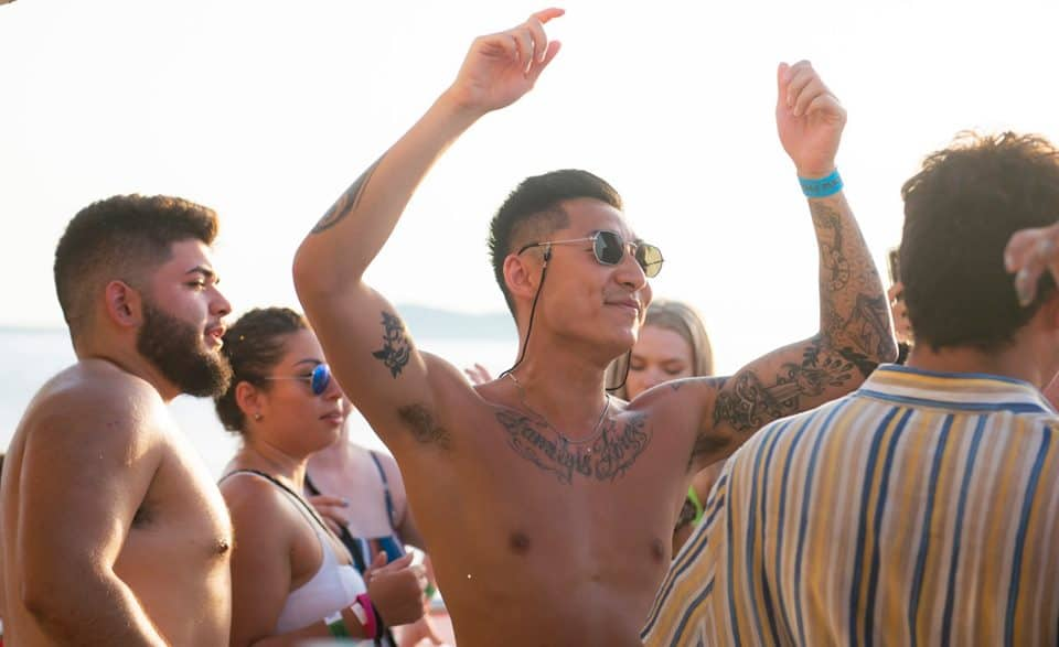 Lad in the Zone soaking up the vibes from the live house music on board the Ibiza Party Boat