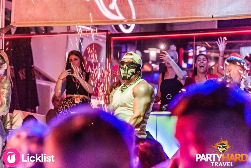 Masked Performer Grinding the Spark Effects on Stage at NightClub Event