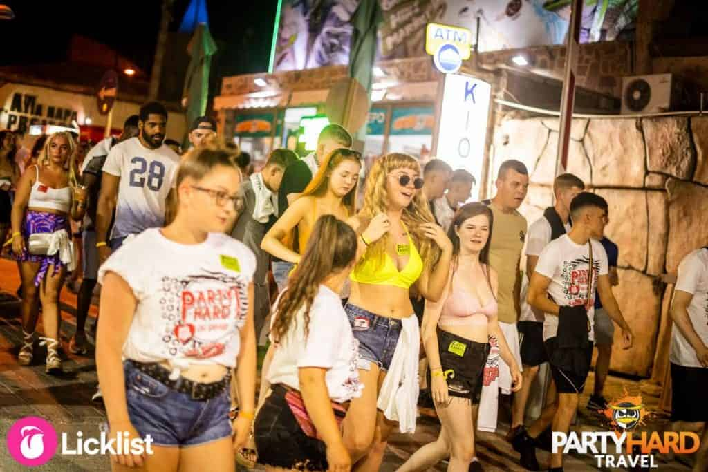 Group of Lads and Girls Walking down the Main Club Strip, evening in Ayia Napa Town Centre