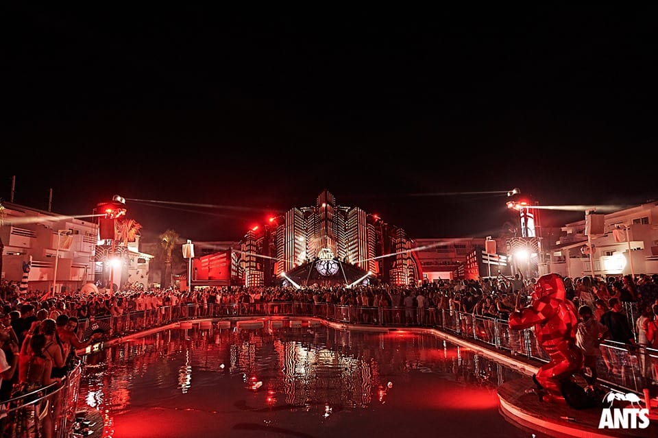 Laser light show at Ants Metropolis event as crowd gathers by the Ushuaïa Hotel Pool, Ibiza