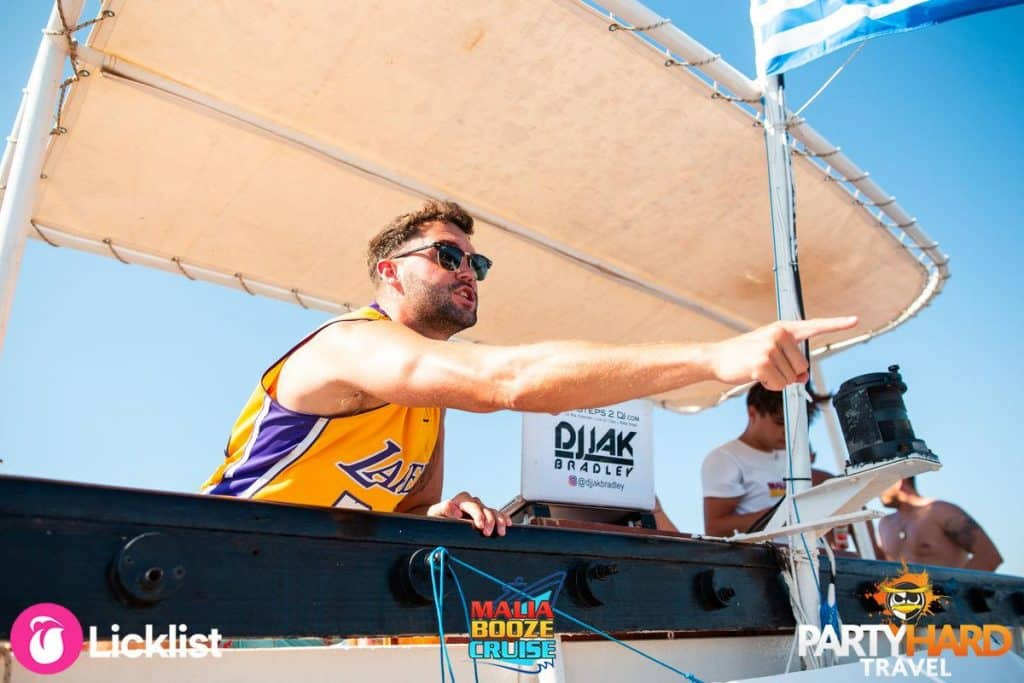 Professional DJ Jak Bradley at the Mixing Decks on the Malia Cruise Revving up the Party