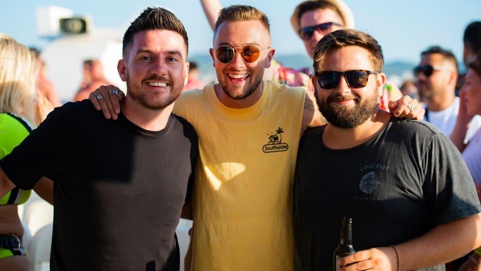 Three lads on board enjoying the Ibiza Pukka Up Boat Party