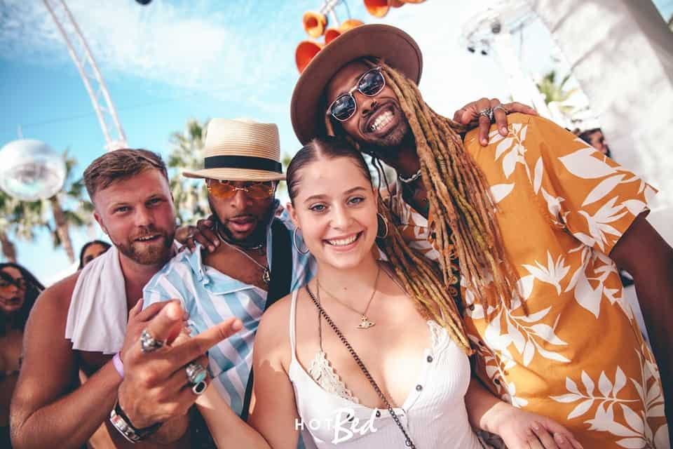 Girl posing for photo with three lads enjoying the vibe of the amazing Ibiza, O Beach party event